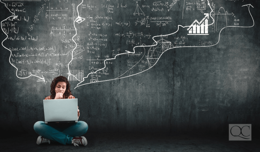 confused girl on laptop, with math equations in the background