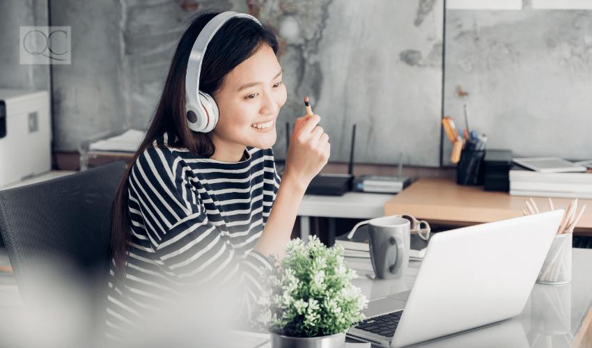 happy woman on laptop