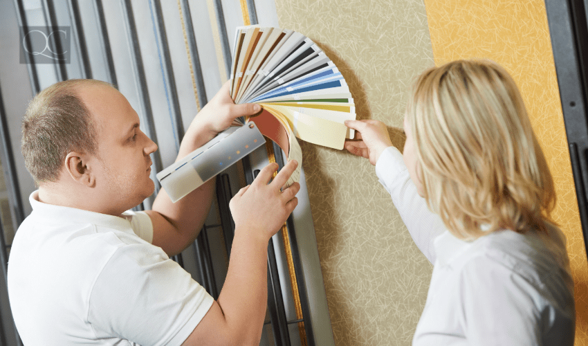 professional designer helping client select paint color from swatch