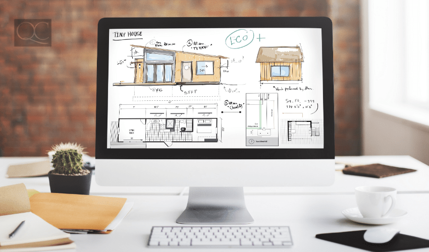 Computer on desk, with home design and floorplan on the screen