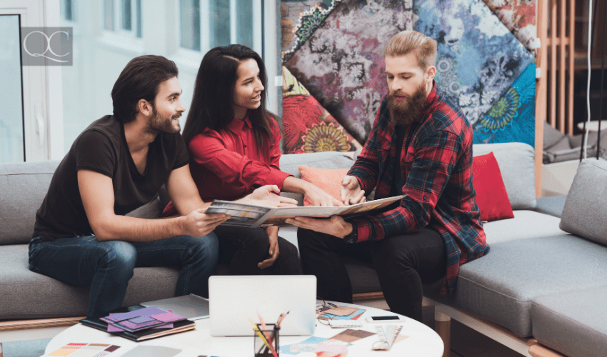 designer showing clients something