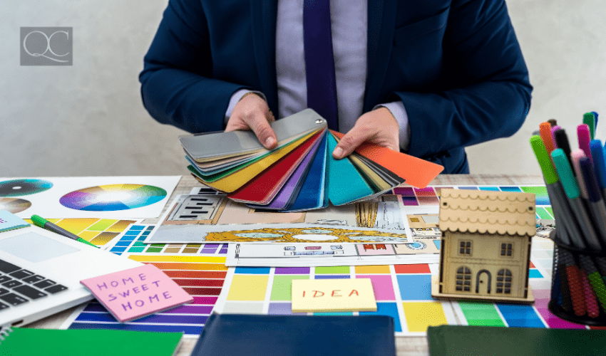 Male designer at desk, holding out color swatches