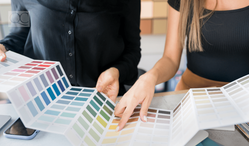 Color consultant showing client color swatches on paper