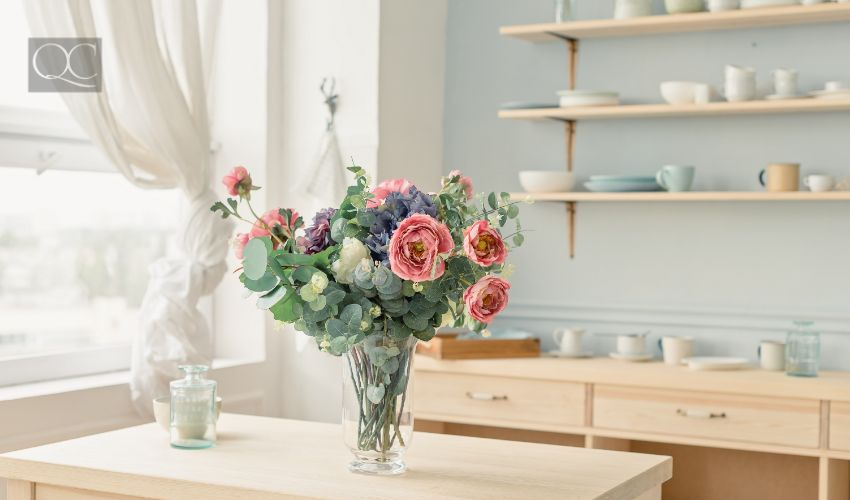 Flowers in vase on the table at modern kitchen