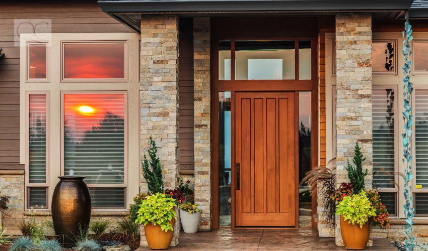 House exterior entry way with wooden door