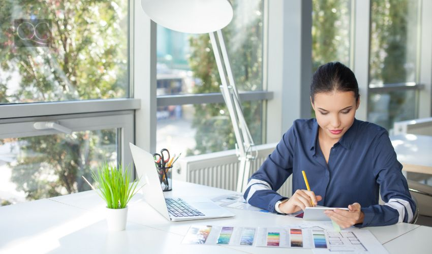 Talented female freelancer is working in office