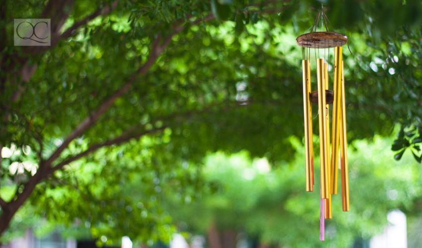 Gold wind bell under the tree.