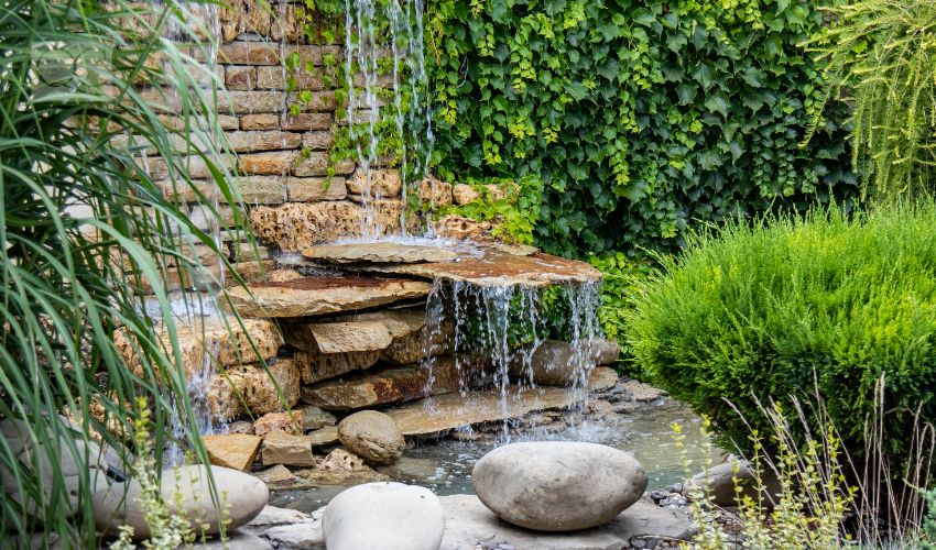 A small decorative waterfall in the garden. Landscape design.