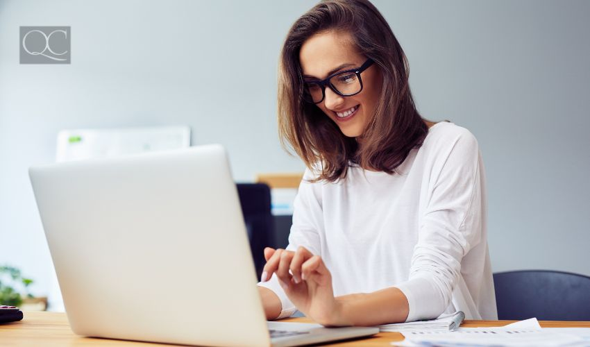 Young woman working with laptop from home office