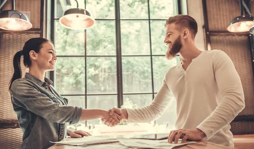 Man and woman shaking hands, collaboration and networking concept.