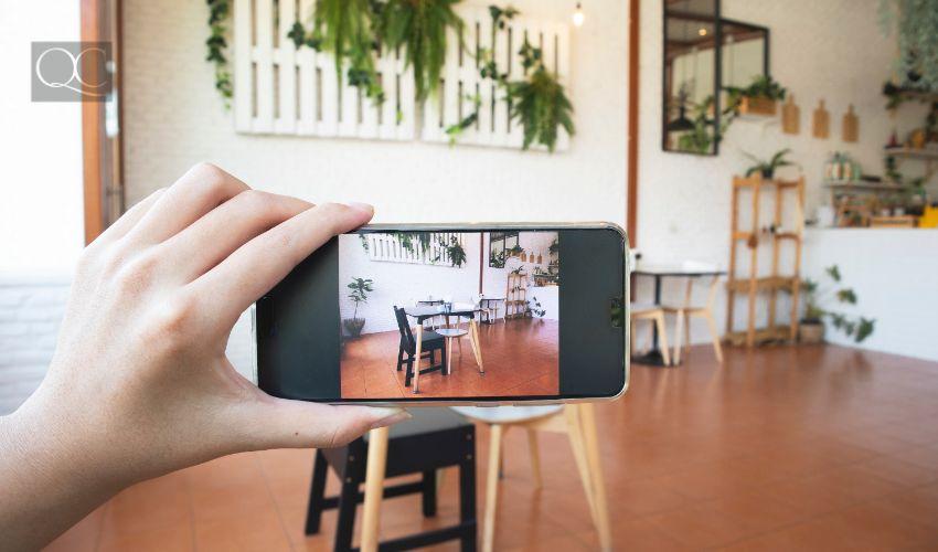 Hand using smart phone take a photo inside a professionally organized home