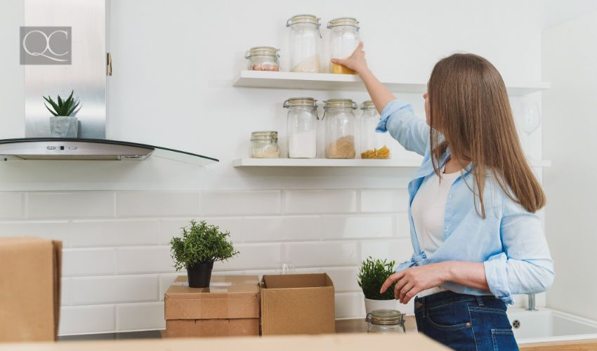 How to become a professional organizer article, last in-post image, woman organizing kitchen shelves