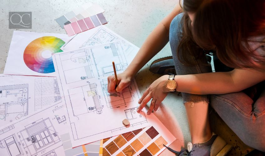 How to become an interior decorator, woman sitting on the floor and drawing plan with art tools